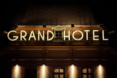 Grand hotel neon sign photographed after dark Stock Photos