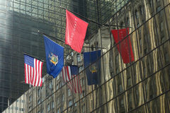 Grand Hyatt Hotel. Three flags outside the Grand Hyatt Hotel, at Grand Central Station: the flag of the company, the coats of arms of New York and the American royalty free stock photography