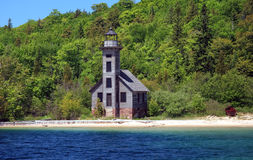 Grand Island East Channel Lighthouse. This is the Grand Island East Channel Lighthouse. The image was taken in the summertime. There is a small rowboat that sits royalty free stock image