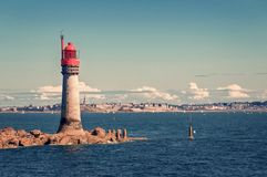 Grand Jardin lighthouse, town of Saint Malo in the background, Brittany France. Grand Jardin lighthouse, town of Saint Malo in the background, Brittany, France royalty free stock image