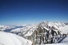 Grand Jorasses and freeriders, extreme ski, Aiguille du Midi, French Alps Royalty Free Stock Photos