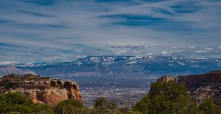 Grand Junction Beneath Grand Mesa. City view from Colorado National Monument. Colorado National Monument offers spectacular views of mountains and rock stock photo