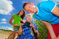 Grand kids and their grandma Stock Photography