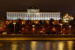 Grand Kremlin Palace and Cathedral of the Annunciation on a background of embankment of Moskva river with night illumination stock photos