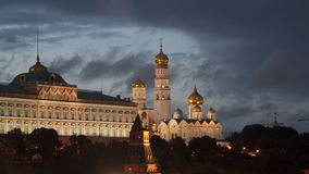 Grand Kremlin Palace and Cathedral of the Annunciation in Moscow. At night. Against the background of moving clouds stock footage