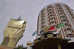 Grand Lisboa Hotel with Casino Lisboa Hotel in Macau. Grand Lisboa Hotel on the left with Casino Lisboa Hotel on the right in Macau. Both are owned by Sociedade Royalty Free Stock Images