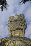 Grand Lisboa Hotel in Macau resembling leaves pattern with actual leaves from trees appearing on top Royalty Free Stock Image