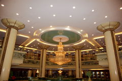 Grand luxurious hotel hall. Large Luxurious interior with high ceiling and posh chandeliers in a Chinese hotel royalty free stock photo