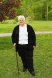Grand-mère avec la canne Photographie stock