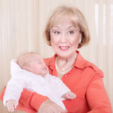 Grand-mère avec le bébé Photos stock