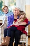 Grand-mère avec le sourire d'enfants Photographie stock libre de droits