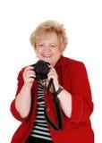 Grand-mère heureuse prenant des photos Photo stock