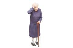 Grand-mère retenant une canne Image libre de droits
