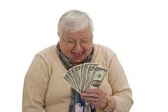 Grand-maman avec des dollars Photographie stock