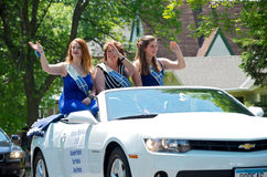 Grand Marshalls Wave to Crowd. West St. Paul, Minnesota, USA – May 21, 2016: Grand Marshalls of 2016 West St. Paul Days Grande Parade from left to right Erin Royalty Free Stock Image