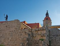 Grand Master's statue on wall in medieval Town of Rhodes Royalty Free Stock Images