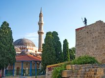 Grand Master's statue and Suleiman's Mosque in medieval Town Rhodes Royalty Free Stock Photos