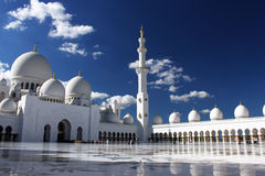 Grand Mosque in Abu Dhabi. The Grand Mosque, also known as Sheikh Zayed Mosque, located in Abu Dhabi. The Mosque is large enough to accommodate 40,000 worshipers Stock Photo