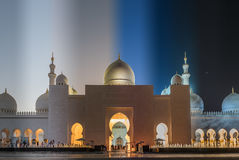 Grand Mosque in Abu Dhabi in Emirates. 2 hours time difference from left to right showing how lights make difference on the mosque Royalty Free Stock Photo