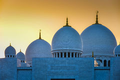 Grand Mosque with domes detail at Sunset. The main domes of a Grand Mosque at sunset Stock Photos