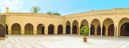 In Grand Mosque of Sousse. The medieval stone courtyard of the Grand Mosque with covered terraces on each side, Sousse, Tunisia Royalty Free Stock Photo