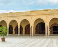 In Grand Mosque of Sousse. SOUSSE, TUNISIA - SEPTEMBER 6, 2015: The old stone arcade in front of the prayer hall of the Grand Mosque, on September 6 in Sousse Royalty Free Stock Photo