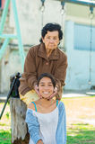 Grand mother standing behind granddaughter Stock Photography