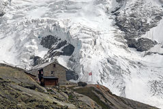 Grand Mountet Hut. The Grand Mountet Hut in front of the glaciers coming down from the Obergabelhorn Royalty Free Stock Photos