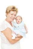 Grand-mère retenant la chéri nouveau-née Images libres de droits