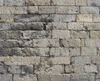 Grand mur en pierre très vieux utilisé dans gris et beige Photo stock