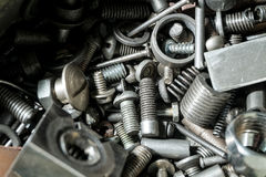 Grand nombre des pièces en métal Photographie stock libre de droits
