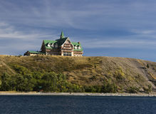 Grand Old Hotel. The historic Prince of Wales Hotel sits on a bluff overlooking Waterton Lake in Waterton Lakes National Park Royalty Free Stock Photos