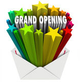 Grand Opening Announcement Letter Envelope Flyer. Grand Opening words shooting out of an envelope or letter to illustrate the excitement of a new store, company Royalty Free Stock Photos