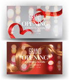 Grand opening banners with curly sparkling ribbons, frames and blurred background. Stock Photo