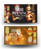Grand opening banners with gold curly sparkling ribbons and blurred background. Royalty Free Stock Photo