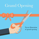 Grand opening concept. Businessman holding pair of scissors in hand cuts red tape with bow. Stock Photo