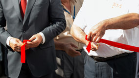 Grand opening, cutting red ribbon. Royalty Free Stock Images
