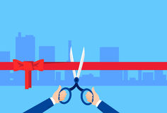 Grand Opening Hand With Scissors Cut Red Ribbon Bow Modern Big City Background Stock Photos