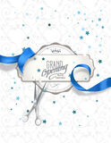 Grand opening invitation card with blue silk ribbon and scissors Stock Photo