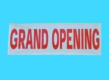 Grand opening sign. Or banner with blue sky background Stock Images