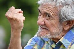 Grand-père masculin bouleversé Photos stock