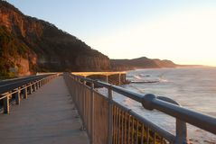 Grand Pacific Drive at Sunrise. Grand Pacific Drive scenic route  walkway in New South Wales, Australia at sunset Stock Image