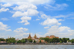 The grand palace along river in bangkok Stock Photos