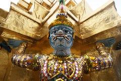 Grand Palace - Bangkok. Mythological figure guarding the buddhist temple in the grand palace, Bangkok royalty free stock images