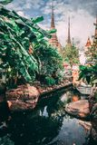 Grand Palace in Bangkok. Towers of Grand Palace reach into the Sky. Little lake inside the temple. royalty free stock photography