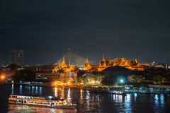 Grand palace and cruise ship in night ,Bangkok city ,Thailand Stock Photos