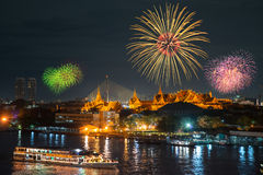 Grand palace and cruise ship in night with fireworks Royalty Free Stock Images