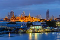 Grand Palace and Emerald Buddha Temple Wat Phra Kaew at twilight time. Bangkok, Thailand royalty free stock photos