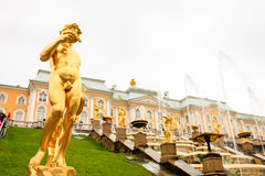 Grand Palace and the Grand cascade fountains in Petergof. The fountains and palace of Petergof are one of Russia`s most famous tourist attractions Stock Photos