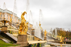 Grand Palace and the Grand cascade fountains in Petergof. The fountains and palace of Petergof are one of Russia`s most famous tourist attractions Stock Photo
